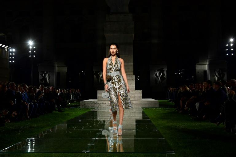 Salvatore Ferragamo's outdoor show, set in a field of sod laid for the occasion, saw models walking the looks on a glass catwalk among bloggers, buyers and fans of the 90-year-old house which won reknown for its shoes