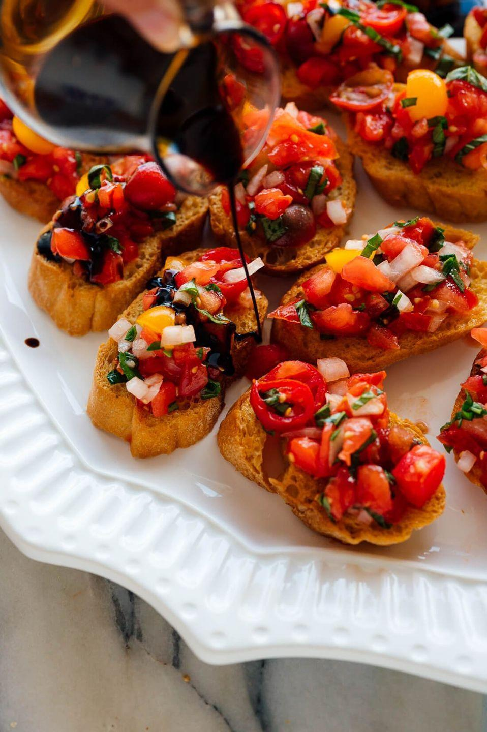 """<p>Serve these pretty crostini topped with marinated tomatoes for your next summer party. If you're planning to make them ahead of time, just be sure to keep the topping separate from the bread until you're ready to serve.<br></p><p><strong>Get the recipe at <a href=""""https://cookieandkate.com/tomato-basil-bruschetta-recipe/"""" rel=""""nofollow noopener"""" target=""""_blank"""" data-ylk=""""slk:Cookie + Kate"""" class=""""link rapid-noclick-resp"""">Cookie + Kate</a>.</strong></p><p><a class=""""link rapid-noclick-resp"""" href=""""https://go.redirectingat.com?id=74968X1596630&url=https%3A%2F%2Fwww.walmart.com%2Fsearch%2F%3Fquery%3Dpioneer%2Bwoman%2Bserving%2Bplates&sref=https%3A%2F%2Fwww.thepioneerwoman.com%2Ffood-cooking%2Fmeals-menus%2Fg36500577%2Ftomato-recipes%2F"""" rel=""""nofollow noopener"""" target=""""_blank"""" data-ylk=""""slk:SHOP SERVING PLATES"""">SHOP SERVING PLATES</a></p>"""