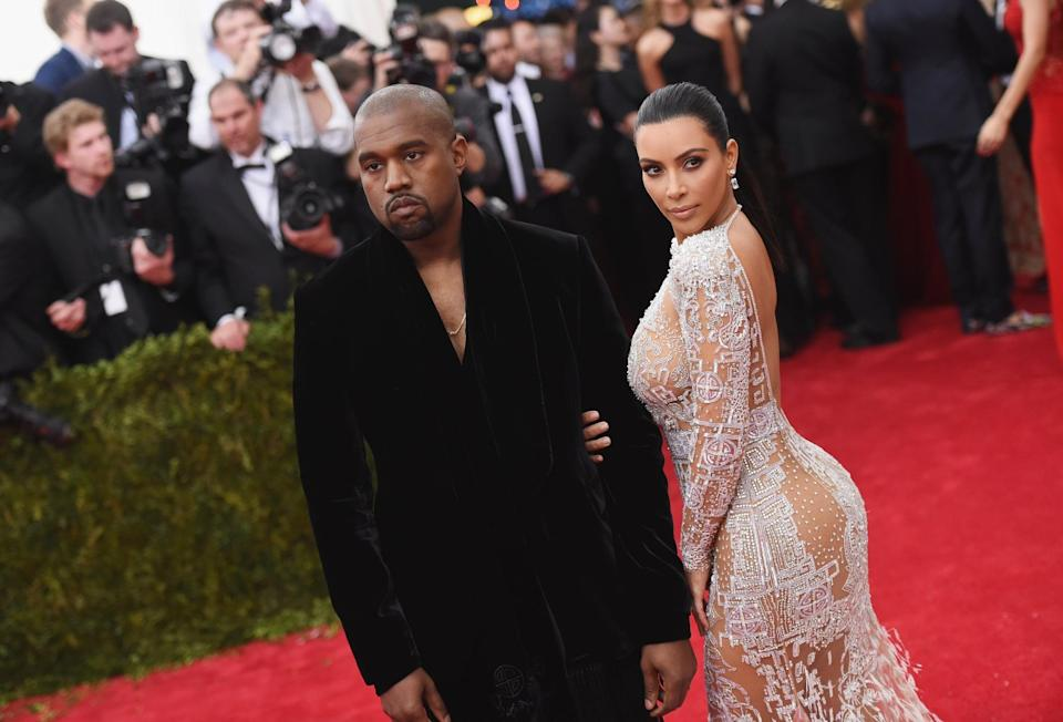 """<p>Kanye pined after <a class=""""link rapid-noclick-resp"""" href=""""https://www.popsugar.com/Kim-Kardashian"""" rel=""""nofollow noopener"""" target=""""_blank"""" data-ylk=""""slk:Kim Kardashian"""">Kim Kardashian</a> for a long, long time (nine years, to be exact) before they finally got together. Kim was working as an assistant to Brandy in 2004 when she first met the """"Famous"""" rapper. She was <a href=""""https://www.popsugar.com/celebrity/Who-Has-Kim-Kardashian-Dated-42475620"""" class=""""link rapid-noclick-resp"""" rel=""""nofollow noopener"""" target=""""_blank"""" data-ylk=""""slk:married to first husband Damon Thomas"""">married to first husband Damon Thomas</a> at the time, so nothing came of it. They reunited a few times over the next couple of years, but due to Kanye's engagement to Alexis and Kim's relationship with Reggie Bush, they still remained in the friend zone. It wasn't until 2011 when <a href=""""https://www.popsugar.com/celebrity/Kim-Kardashian-Kris-Humphries-Divorce-20212486"""" class=""""link rapid-noclick-resp"""" rel=""""nofollow noopener"""" target=""""_blank"""" data-ylk=""""slk:Kim divorced Kris Humphries"""">Kim divorced Kris Humphries</a> that the stars finally aligned. By 2013, Kanye popped the question with an <a href=""""https://www.popsugar.com/celebrity/Kim-Kardashian-Kanye-West-Engaged-32230091"""" class=""""link rapid-noclick-resp"""" rel=""""nofollow noopener"""" target=""""_blank"""" data-ylk=""""slk:over-the-top San Francisco proposal"""">over-the-top San Francisco proposal</a>, and in 2014 <a href=""""https://www.popsugar.com/celebrity/Kim-Kardashian-Kanye-West-Wedding-Pictures-2014-34831104"""" class=""""link rapid-noclick-resp"""" rel=""""nofollow noopener"""" target=""""_blank"""" data-ylk=""""slk:they tied the knot in Italy"""">they tied the knot in Italy</a>. Sadly, <a href=""""https://www.popsugar.com/celebrity/kim-kardashian-and-kanye-west-divorce-48092756"""" class=""""link rapid-noclick-resp"""" rel=""""nofollow noopener"""" target=""""_blank"""" data-ylk=""""slk:their relationship came to an end"""">their relationship came to an end</a> in January 2021 when Kim filed for divorce after six"""