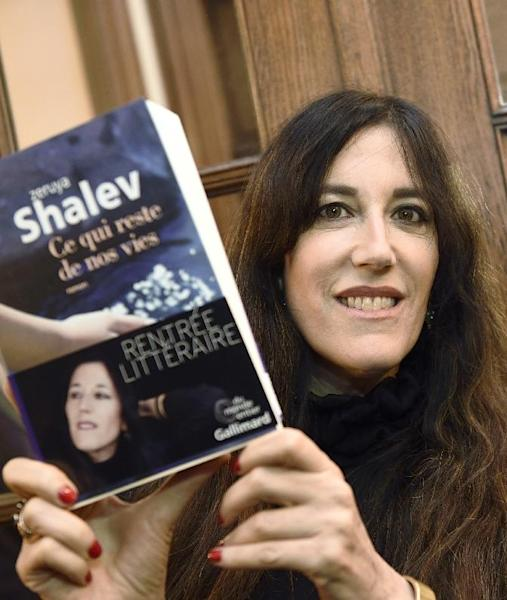 """Israeli writer Zeruya Shalev poses on November 3, 2014 in Paris after she was awarded the Prix Femina literary prize for best foreign novel, for """"Ce qui reste de nos vies"""" (The Remains of Love) (AFP Photo/Eric Feferberg)"""