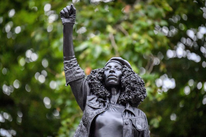 A black resin and steel statue titled A Surge of Power (Jen Reid) 2020, by Marc Quinn is installed on the vacant Edward Colston plinth in Bristol city centre. (Photo: PA)