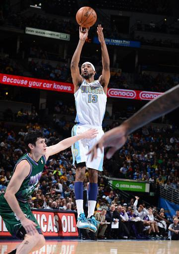DENVER, CO - FEBRUARY 5: Corey Brewer #13 of the Denver Nuggets shoots a wide-open shot versus the Milwaukee Bucks on February 5, 2013 at the Pepsi Center in Denver, Colorado. (Photo by Garrett W. Ellwood/NBAE via Getty Images)