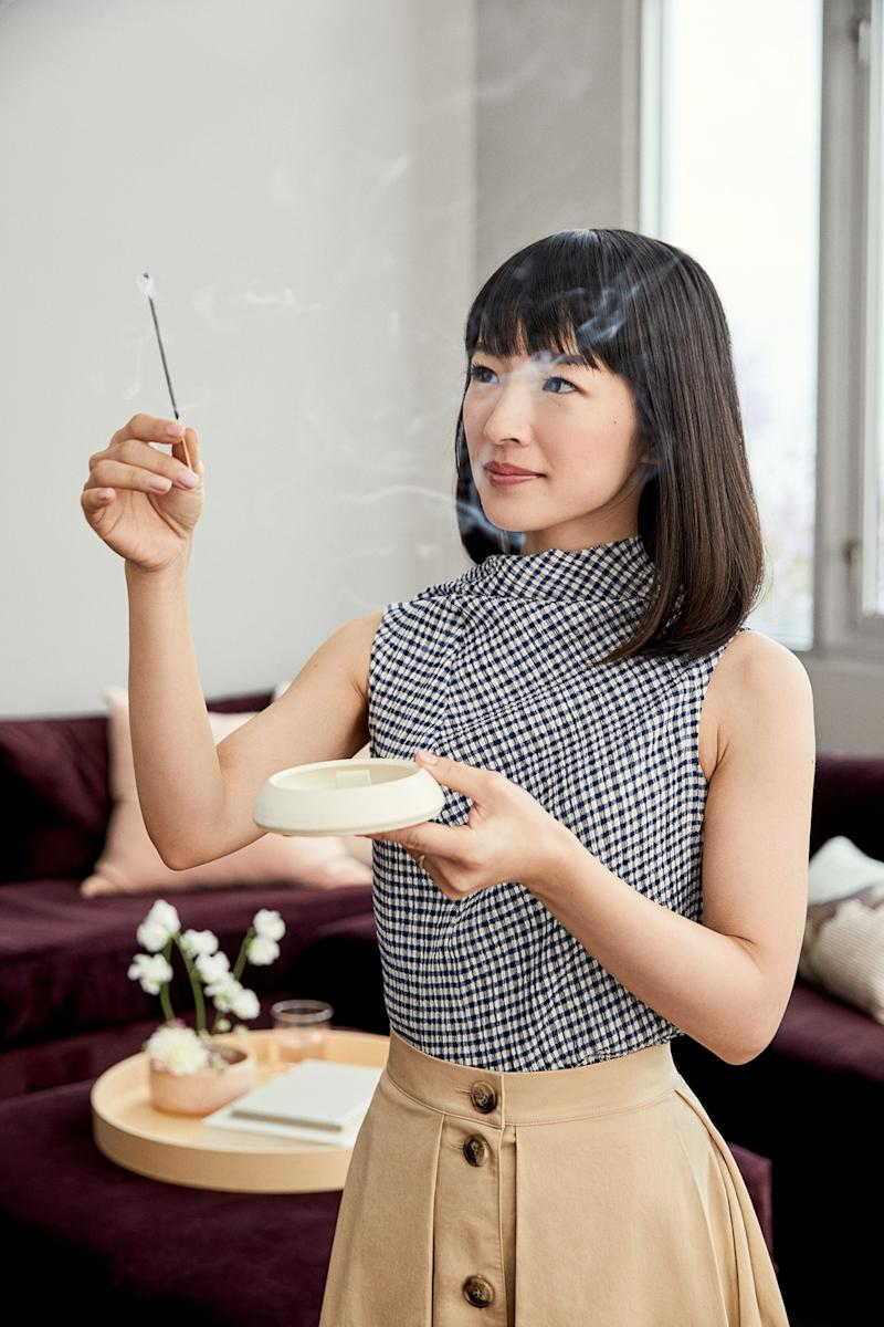 marie kondo working with incense stick