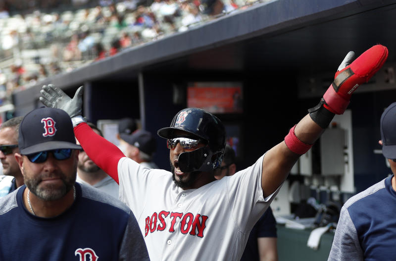 Boston Red Sox third baseman Eduardo Nunez (36) reacts after scoring on an Ian Kinsler double in the fifth inning of baseball game against <g class=
