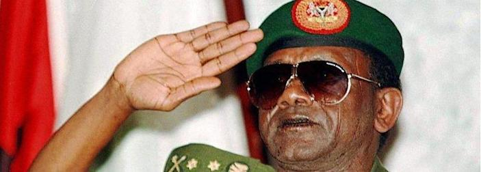 """Picture dated 30 August shows Nigerian President General Sani Abacha at the last session of the summit meeting of the Economic Community of West African States (ECOWAS) in Abuja. Britain ruled out 22 October allowing a Nigerian delegation to attend the next Commonwealth summit scheduled to begin 24 October in Edinburgh. """"They would need visas to get over here and under the present restrictions they would be unable to obtain them"""". Nigeria was suspended from the Commonwealth after the execution of nine human rights activists in November 1995."""