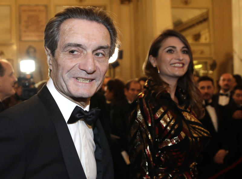 "Lombardy region president Attilio Fontana arrives daughter Maria Cristina flanked by his for the gala premiere of La Scala opera house, in Milan, Italy, Saturday, Dec. 7, 2019. Milan's storied La Scala opens its 2019-2020 season on Saturday with Puccini's ""Tosca,"" which stars Russian soprano Anna Netrebko as the object of unwanted sexual attention from a powerful authority figure. (AP Photo/Luca Bruno)"