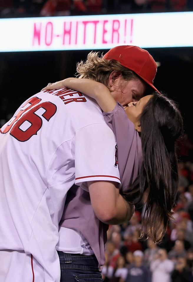 ANAHEIM, CA - MAY 02:  Starting pitcher Jered Weaver #36 of the Los Angeles Angels of Anaheim receives a kiss from his wife Kristin after throwing a no-hitter against the Minnesota Twins at Angel Stadium of Anaheim on May 2, 2012 in Anaheim, California. The Angels defeated the Twins 9-0.  (Photo by Jeff Gross/Getty Images)