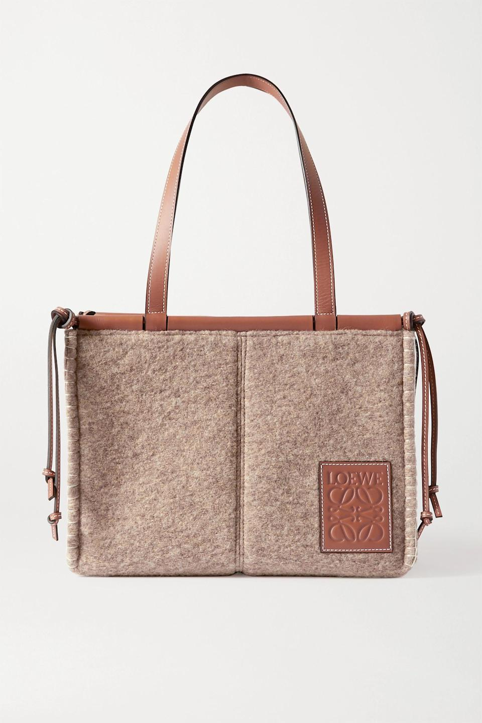 """<p><strong>Loewe</strong></p><p>net-a-porter.com</p><p><strong>$1200.00</strong></p><p><a href=""""https://go.redirectingat.com?id=74968X1596630&url=https%3A%2F%2Fwww.net-a-porter.com%2Fen-us%2Fshop%2Fproduct%2Floewe%2Fcushion-small-leather-trimmed-felt-tote%2F1296175&sref=https%3A%2F%2Fwww.harpersbazaar.com%2Ffashion%2Fg34046218%2Fspring-2021-bag-trends%2F"""" rel=""""nofollow noopener"""" target=""""_blank"""" data-ylk=""""slk:Shop Now"""" class=""""link rapid-noclick-resp"""">Shop Now</a></p><p>This bag gives us the same vibes as Loewe's famed woven bags, but for all-year-round.</p>"""