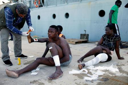 FILE PHOTO: Migrants arrive at a naval base after they were rescued by Libyan coastal guards in Tripoli, Libya November 6, 2017. REUTERS/Ahmed Jadallah/File Photo