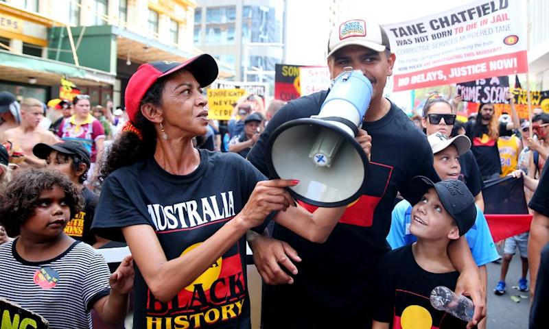 NRL player Latrell Mitchell ensures his voice can be heard during the Invasion Day rally in Sydney