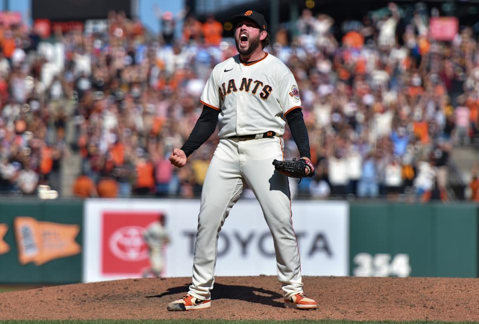 Dominic Leone of the San Francisco Giants celebrates after a win over the Padres to clinch the NL West. (Photo by Brandon Vallance/Getty Images)