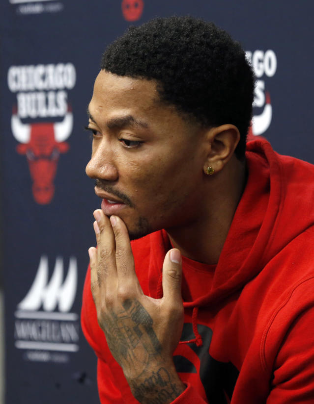 Chicago Bulls guard Derrick Rose responds to a question about his injured knee during an NBA basketball news conference at the United Center Thursday, Dec. 5, 2013, in Chicago. (AP Photo/Charles Rex Arbogast)