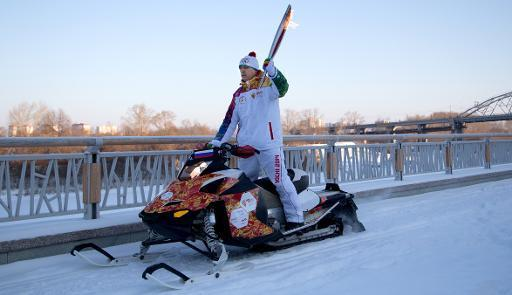 A torchbearer rides with the Olympic torch in the Siberian city of Tyumen, 2144 km east of Moscow, on December 11, 2013