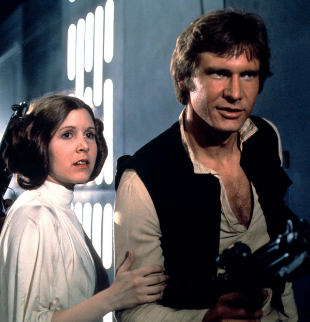 Carrie Fisher and Harrison ford in <em>Star Wars</em>. (Photo: Everett Collection)