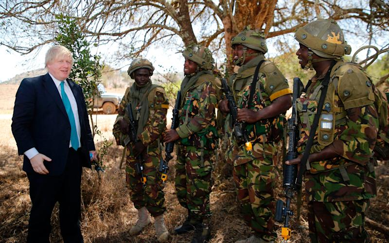 Boris Johnson talks to Kenyan soldiers training alongside British soldiers in northern Kenya - Credit: AFP/Getty Images