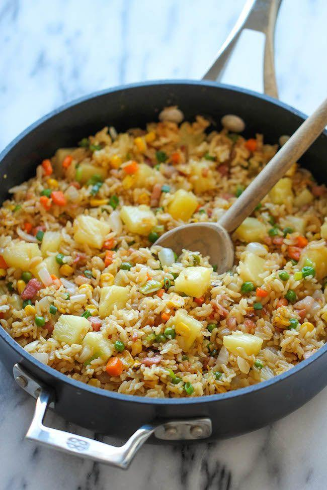 """<p>This mix of pineapple, smoked ham, brown rice, and veggies will taste better bite after bite. </p><p><strong>Get the recipe at <a href=""""http://damndelicious.net/2014/06/25/pineapple-fried-rice/"""" rel=""""nofollow noopener"""" target=""""_blank"""" data-ylk=""""slk:Damn Delicious"""" class=""""link rapid-noclick-resp"""">Damn Delicious</a>.</strong> </p>"""