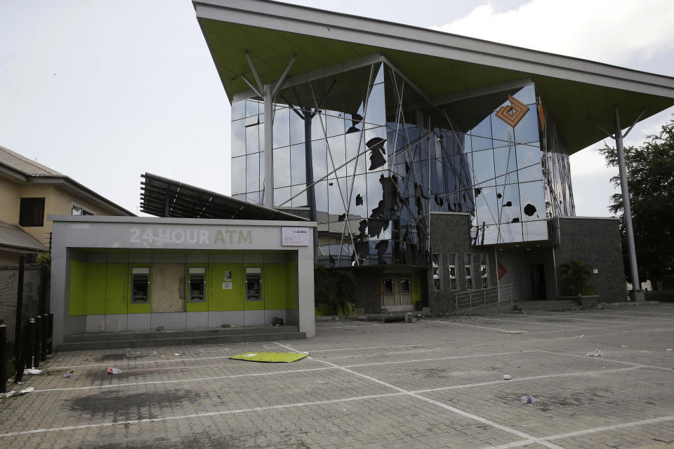 A damaged access bank in Lekki Lagos Friday, Oct. 23, 2020.Resentment lingered with the smell of charred tires Friday as Nigeria's streets were relatively calm after days of protests over police abuses, while authorities gave little acknowledgement to reports of the military killing at least 12 peaceful demonstrators earlier this week.(AP Photo/Sunday Alamba)