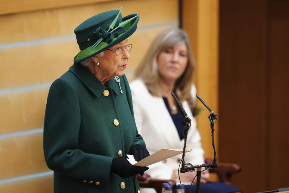 Britain's Queen Elizabeth II delivers her speech in the debating chamber to mark the official start of the sixth session of the Scottish Parliament, in Edinburgh, Scotland, Saturday, Oct. 2, 2021. (Jane Barlow/Pool Photo via AP)