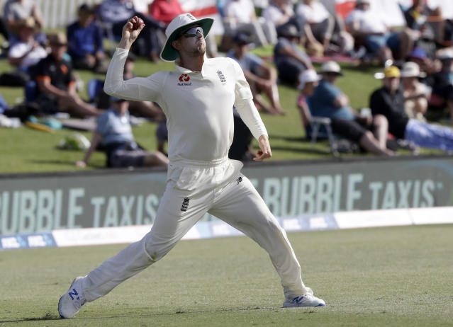 England's Joe Denly throws the ball back to a teammate during play on day two of the first cricket test between England and New Zealand at Bay Oval in Mount Maunganui, New Zealand, Friday, Nov. 22, 2019. (AP Photo/Mark Baker)
