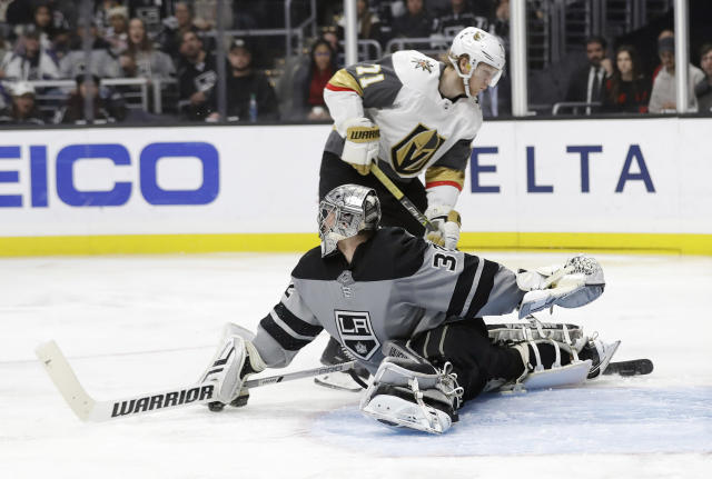 Vegas Golden Knights' William Karlsson, top, scores past Los Angeles Kings goaltender Jonathan Quick during the third period of an NHL hockey game Saturday, Dec. 29, 2018, in Los Angeles. (AP Photo/Marcio Jose Sanchez)