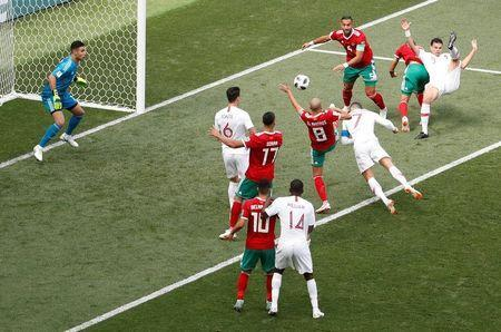 Soccer Football - World Cup - Group B - Portugal vs Morocco - Luzhniki Stadium, Moscow, Russia - June 20, 2018 Portugal's Cristiano Ronaldo scores their first goal REUTERS/Christian Hartmann