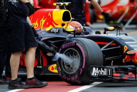 Formula One - F1 - Australian Grand Prix - Melbourne, Australia - 25/03/2017 Red Bull Racing driver Max Verstappen of the Netherlands has his brakes cooled in the pits during the qualifying session. REUTERS/Brandon Malone
