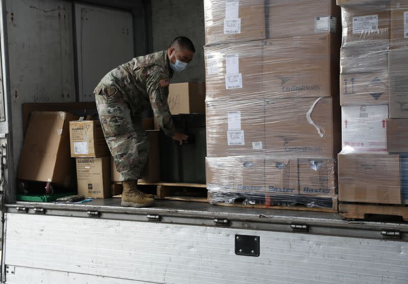 A U.S. army soldier moves a box containing the coronavirus disease (COVID-19) vaccines at Allgood Army Community Hospital located inside U.S. Army Garrison Humphreys in Pyeongtaek