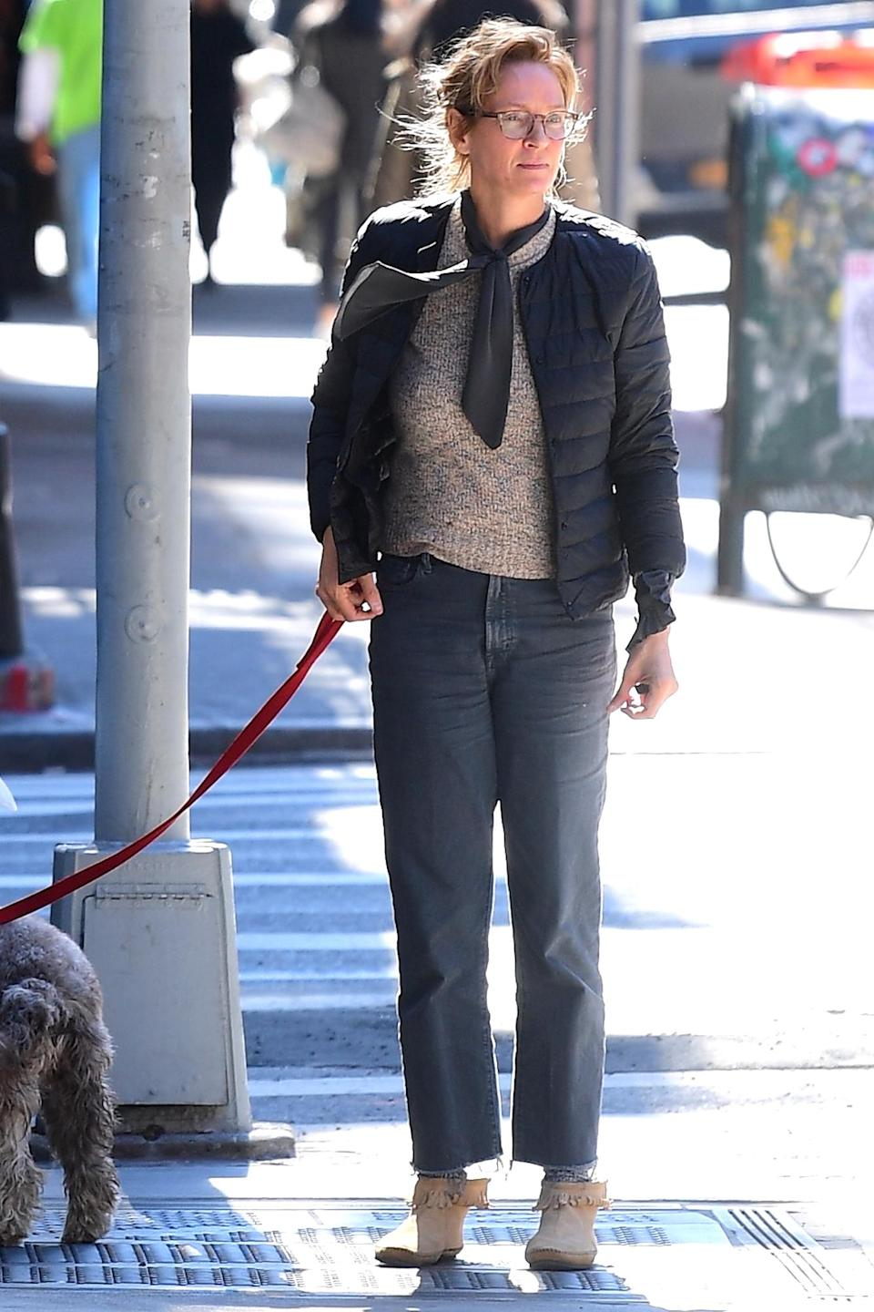 <p>Uma Thurman took her dog for a walk in New York City.</p>