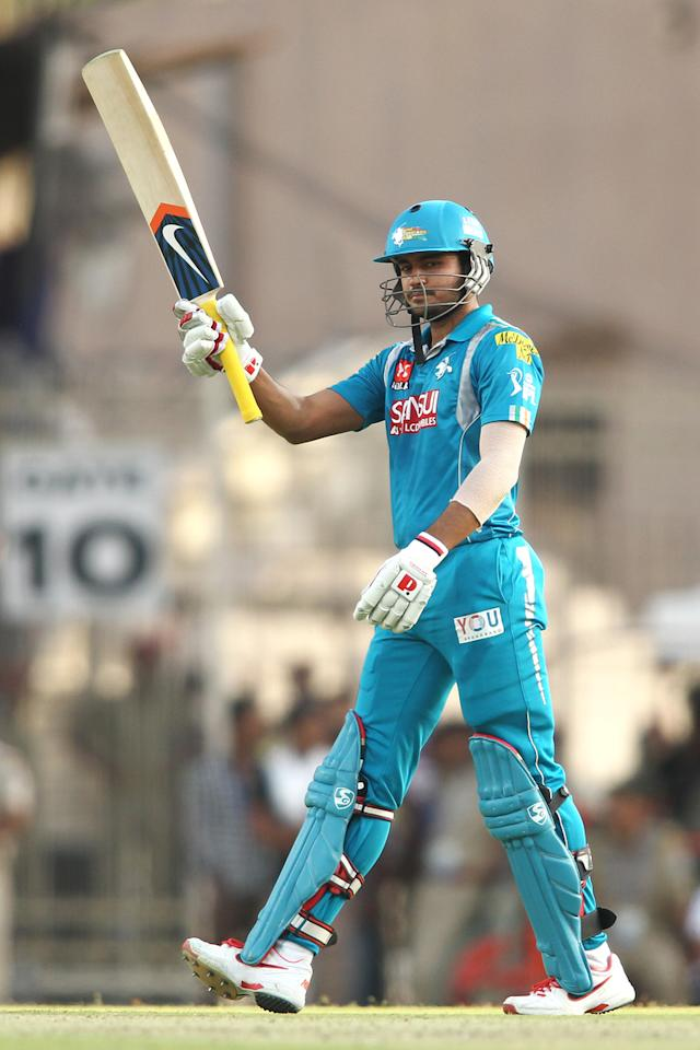 Manish Pandey of Pune Warriors India raises his bat after reaching his fifty during match 65 of the Pepsi Indian Premier League between The Kolkata Knight Riders and the Pune Warriors India held at the JSCA International Stadium Complex, Ranchi, India on the 15th May 2013..Photo by Shaun Roy-IPL-SPORTZPICS    ..Use of this image is subject to the terms and conditions as outlined by the BCCI. These terms can be found by following this link:..https://ec.yimg.com/ec?url=http%3a%2f%2fwww.sportzpics.co.za%2fimage%2fI0000SoRagM2cIEc&t=1506172772&sig=7npRf7Tsb.96g6lb6kalmA--~D
