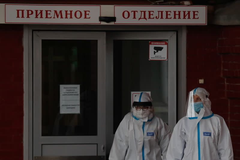 Medical specialists walk outside a hospital, amid the outbreak of the coronavirus disease (COVID-19) in Saint Petersburg