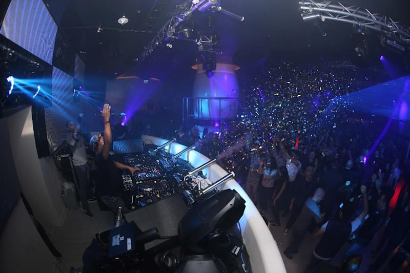 DJ Erick Morillo leads the crowd at the Pacha nightclub opening in Macau (AFP Photo/KESTER)