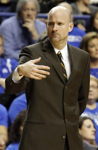 Mississippi head coach Andy Kennedy directs his team during the first half of an NCAA college basketball game in Lexington, Ky., Saturday, Feb. 18, 2012. Kentucky won 77-62. (AP Photo/James Crisp)