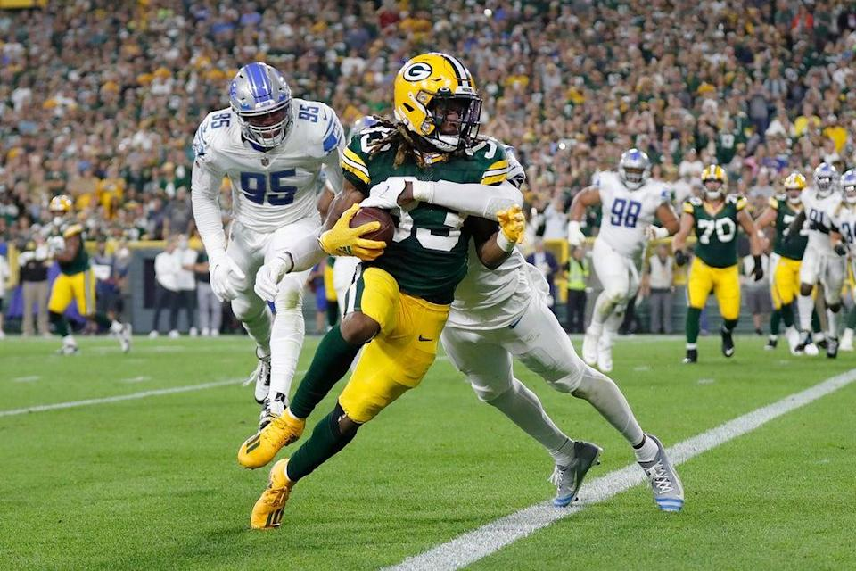 Aaron Jones lost a pendant containing his father's ashes while scoring against the Detroit Lions  (Getty Images)
