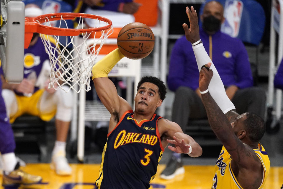 Golden State Warriors guard Jordan Poole, left, shoots as Los Angeles Lakers forward LeBron James defends during the second half of an NBA basketball Western Conference Play-In game Wednesday, May 19, 2021, in Los Angeles. (AP Photo/Mark J. Terrill)