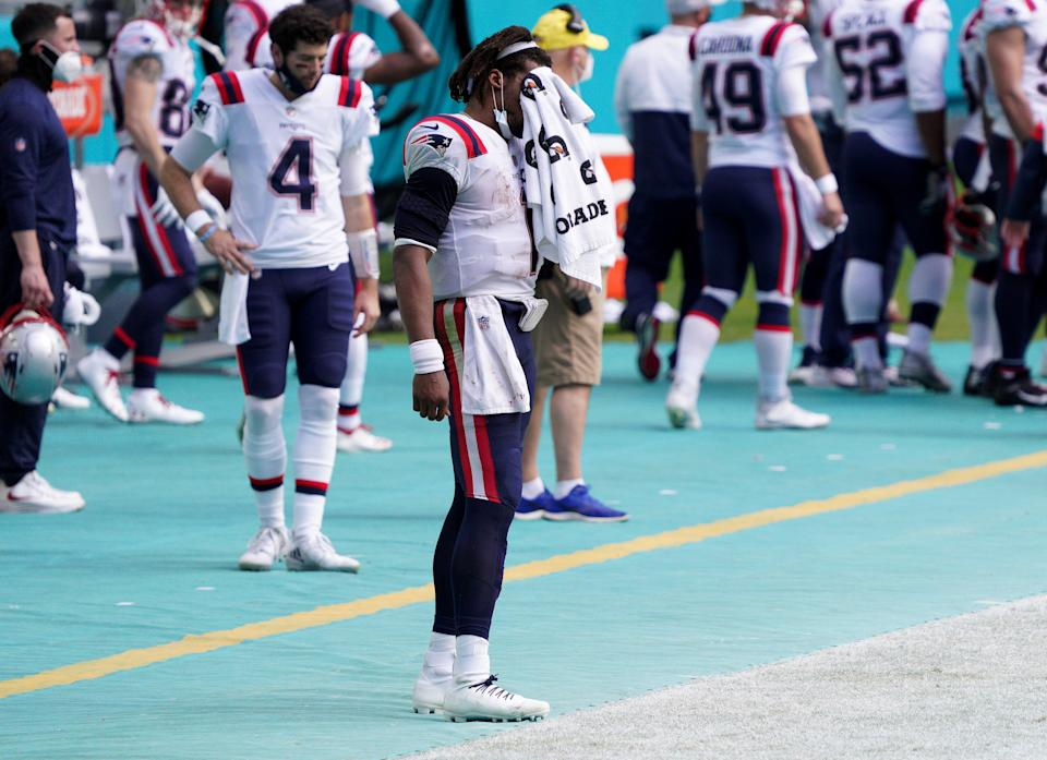 MIAMI GARDENS, FLORIDA - DECEMBER 20: Cam Newton #1 of the New England Patriots stands on the sideline against the Miami Dolphins during the second quarter in the game at Hard Rock Stadium on December 20, 2020 in Miami Gardens, Florida. (Photo by Mark Brown/Getty Images)