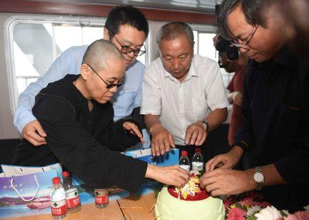 Liu Xia, wife of deceased Chinese Nobel Peace Prize-winning dissident Liu Xiaobo and other relatives attend his sea burial at unknown location at sea, China
