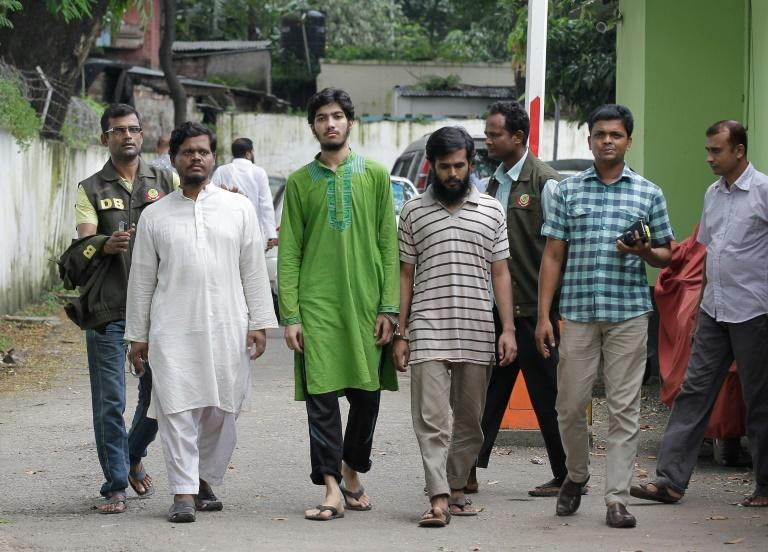 Bangladesh police escort members of Islamic group the Ansarullah Bangla Team (ABT) after they were arrested over the murder of two bloggers in Dhaka, in September 2015