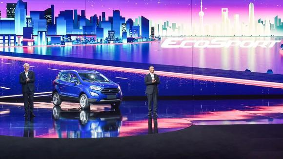Two Ford executives standing next to the new EcoSport on stage.
