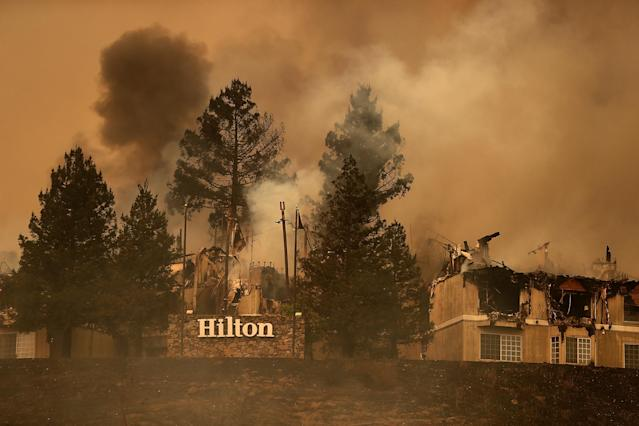 <p>Smoke continues to rise from the Hilton Sonoma Wine Country on Oct. 9, 2017 in Santa Rosa, Calif. (Photo: Justin Sullivan/Getty Images) </p>