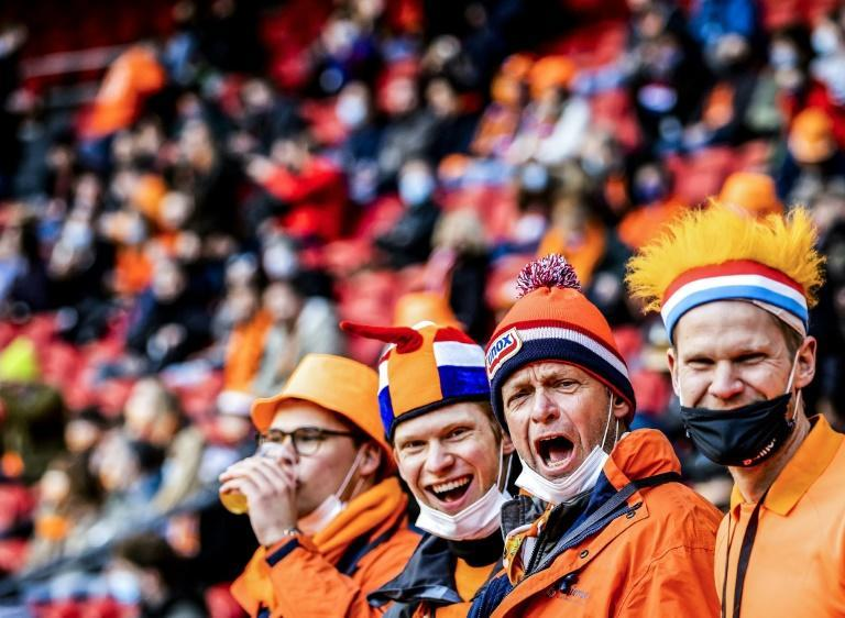 Dutch fans cheer on their team during the World Cup qualifying win over Latvia