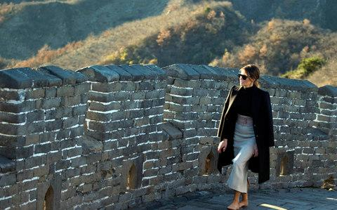 Melania Trump walks along the Mutianyu Great Wall section n Beijing - Credit: AP