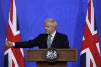 Britain's Prime Minister Boris Johnson gestures as he answers a question from the media at a press conference about the ongoing coronavirus outbreak, in London, Friday, May 14, 2021. (AP Photo/Matt Dunham, Pool)