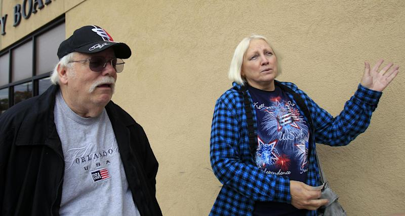 This photo taken Oct. 19, 2012 shows retirees Chuck and Linda Wirebaugh, from Cortland, Ohio, discussing politics after voting at the Trumbull County Board of Elections in Warren, Ohio. President Barack Obama's decision to help America's automakers could end up being what helps drive him back into the White House. Some 850,000 jobs in this critical battleground state are tied to autos and Obama's campaign constantly reminds voters they'd be jobless if not for the decision to inject taxpayer dollars into General Motors and Chrysler. (AP Photo/Tony Dejak)