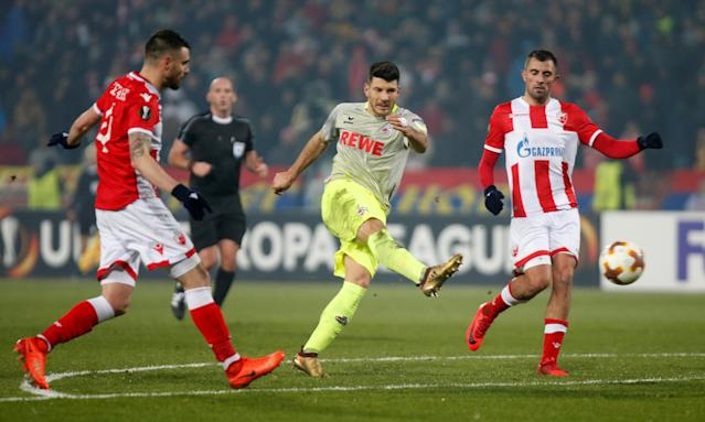 Soccer Football - Europa League - Red Star Belgrade vs FC Cologne - Rajko Mitic Stadium, Belgrade, Serbia - December 7, 2017 Cologne's Milos Jojic has a shot at goal as Red Star Belgrade's Damien Le Tallec and Nenad Krsticic attempt to block REUTERS/Novak Djurovic