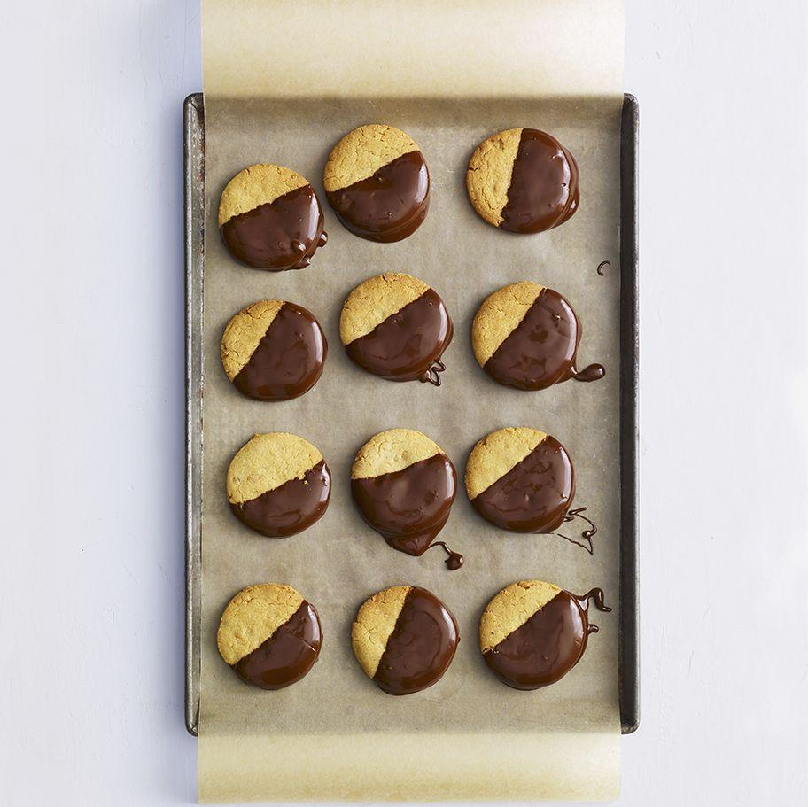 """<p>The most iconic dessert duo (chocolate and peanut butter, of course) comes together for this riff on a black-and-white cookie.</p><p><em><a href=""""https://www.womansday.com/food-recipes/food-drinks/a29505129/chocolate-dipped-peanut-cookies-recipe/"""" rel=""""nofollow noopener"""" target=""""_blank"""" data-ylk=""""slk:Get the recipe from Woman's Day »"""" class=""""link rapid-noclick-resp"""">Get the recipe from Woman's Day »</a></em></p>"""
