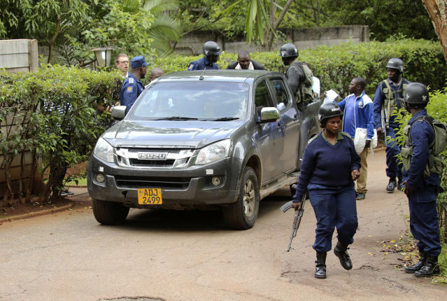 Armed police officers outside the residence of Evan Mawarire, an activist and pastor who helped mobilize people to protest against the hike in fuel prices, following his arrest in Harare, Zimbabwe, Wednesday, Jan. 16, 2019. Mawarire was arrested Wednesday for allegedly inciting violence in the protests against the government's increase in fuel prices. (AP Photo/Tsvangirayi Mukwazhi)