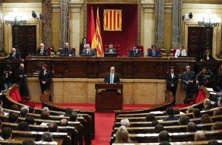 Catalan regional deputy Jordi Turull delivers his speech during his investiture session as new Catalan President at regional parliament in Barcelona, Spain, March 22, 2018.