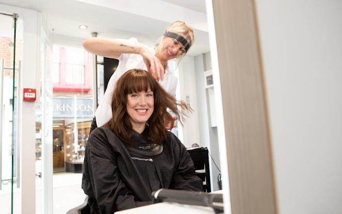 Maria Lally with hairdresser Amy at the Headmasters salon in Windsor