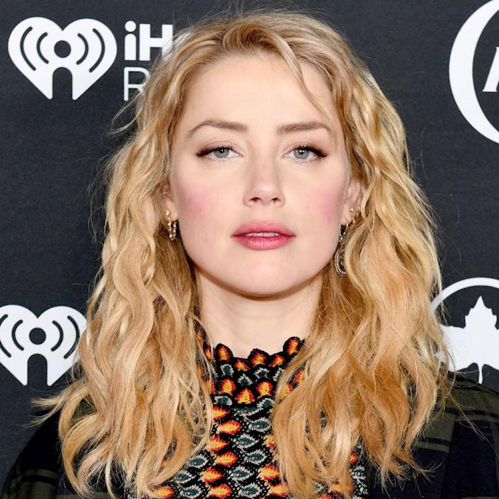 """Beige gets a bad wrap, and Amber Heard is here to give the tone a new reputation. This pale and sandy yellowish tone is deeply flattering against a range of skin tones, including Heard's rosy ivory. """"Amber has a visibly peachy skin tone which is accentuated nicely in contrast by beige tones since they aren't overtly warm,"""" says Bradford. """"With this particular skin tone, it has a tendency to look washed out and it's always a good idea to ask your colorist to maintain some form of depth when highlighting for a dimensional look."""" It would also look great against olive tones, too."""