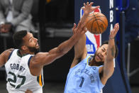 Memphis Grizzlies forward Kyle Anderson (1) and Utah Jazz center Rudy Gobert (27) vie for a rebound during the first half of Game 3 of an NBA basketball first-round playoff series Saturday, May 29, 2021, in Memphis, Tenn. (AP Photo/John Amis)